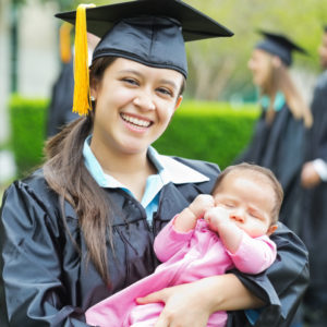 Happy mom holding her baby after graduating college